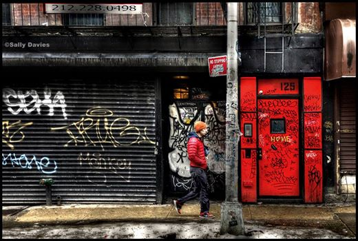 Bold Impact Paired With Urban Graffiti:  The Vibrant Red Door